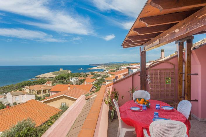 fotografia di architettura realizzata a Torre del Pozzo con bellissima vista su S'Archittu e il mare. Sardegna