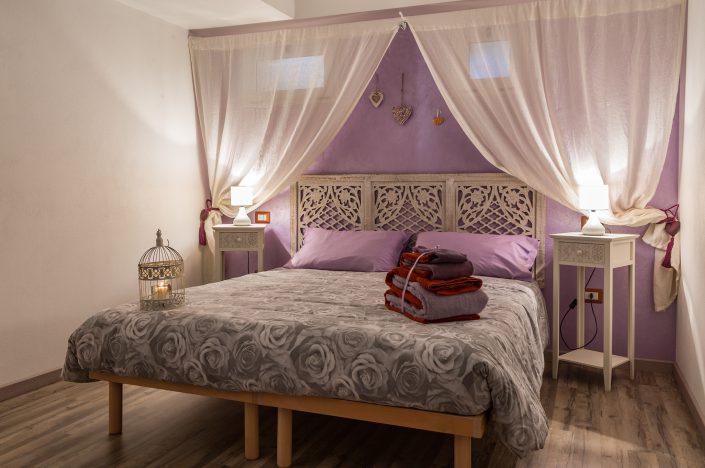 fotografia di una stanza da letto di un B&B di Cabras